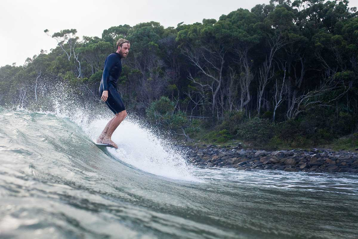 Nose riding in Jory mens shortie wetsuit by Neon Wetsuits