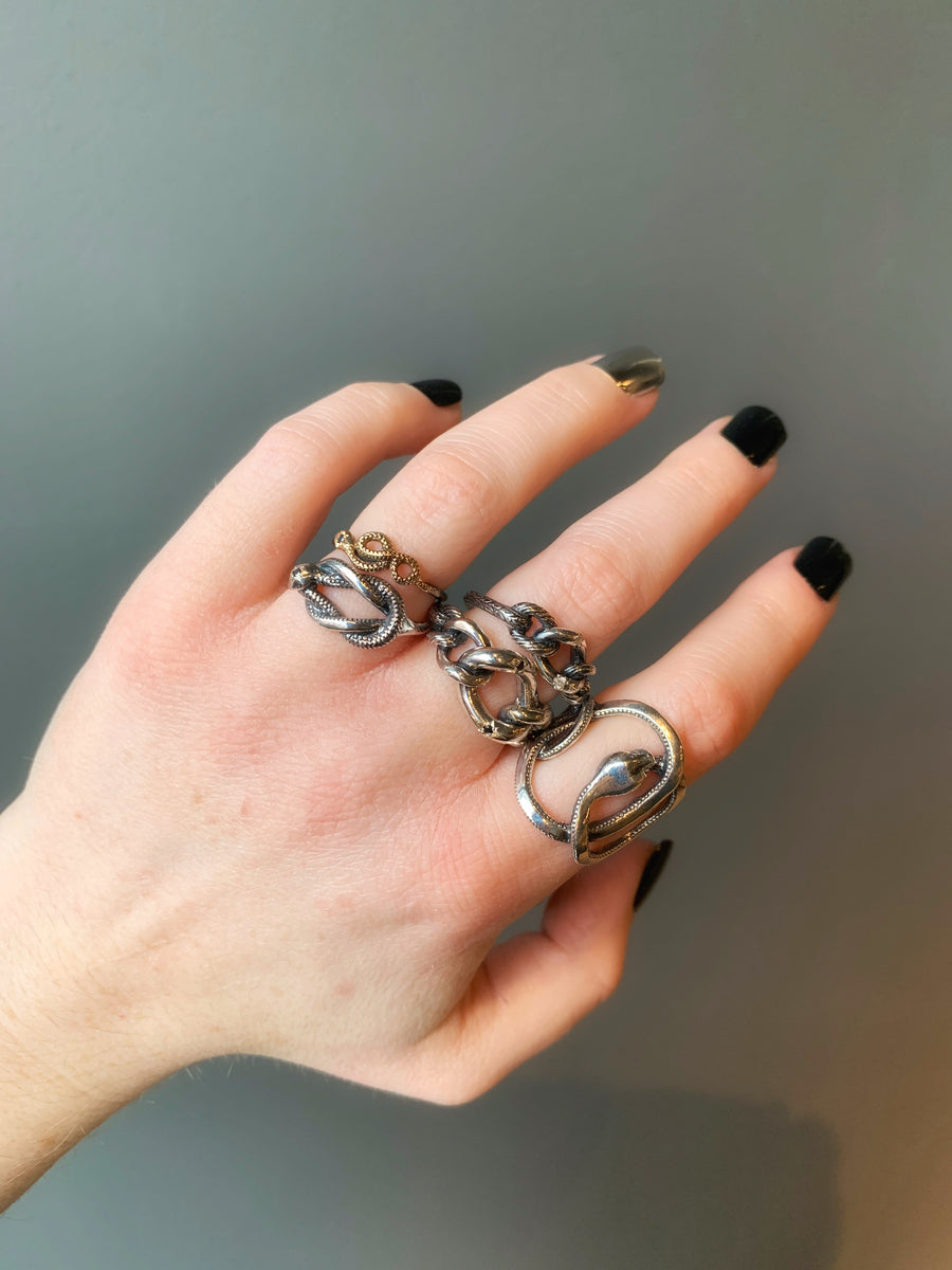 Rusty Thought rings modeled on a woman's hand