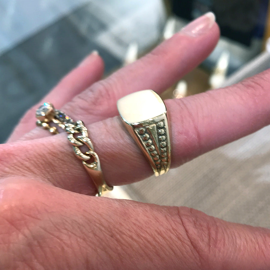 Arik Kastan 14k Gold Signet Ring modeled on a woman's finger