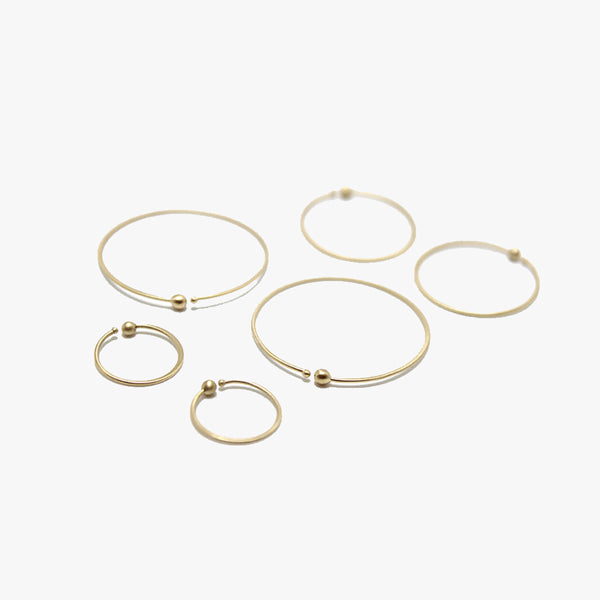 Carla Caruso 14k gold loop hoops in three different sizes