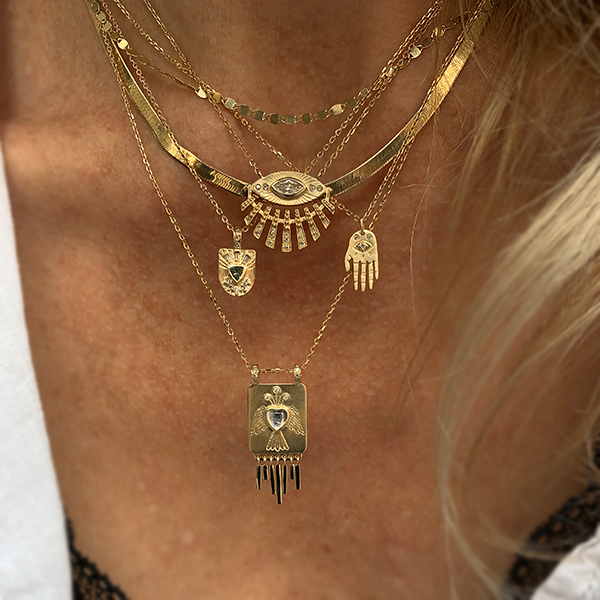 Celine Daoust necklaces layered on a woman's neck