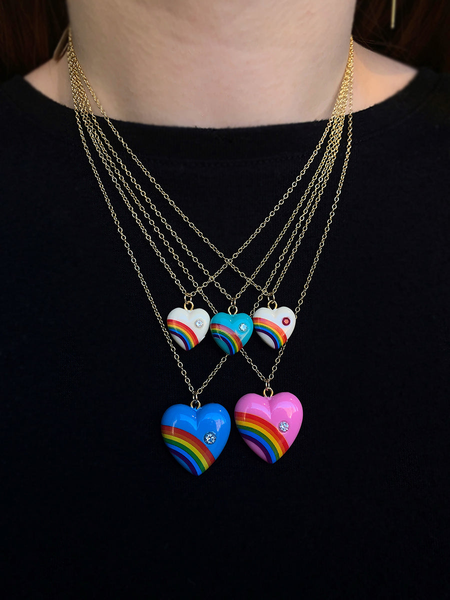 Elisabeth Bell Vintage Rainbow Heart Necklaces modeled on a woman's neck