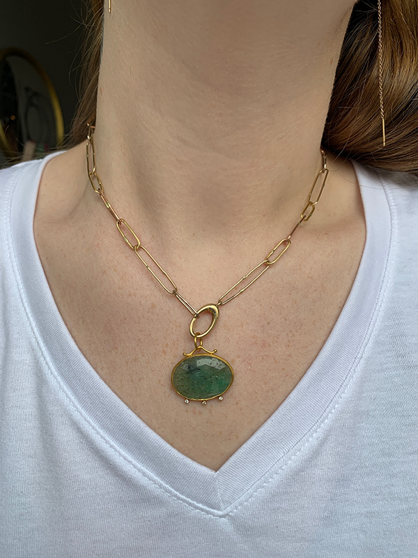 24k Gold Emerald + Diamond Charm modeled on the Variance Objects solid gold link chain necklace on a woman's neck