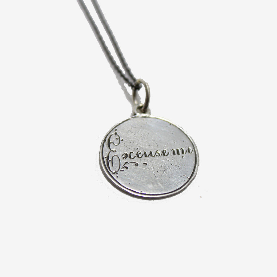 Heavenly Vices Silver Love Token engraved with the phrase 'Excuse Me'