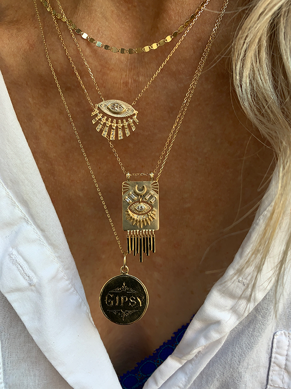 Celine Daoust 14k Moon & Sun Eye Talisman Necklace modeled on a woman's neck
