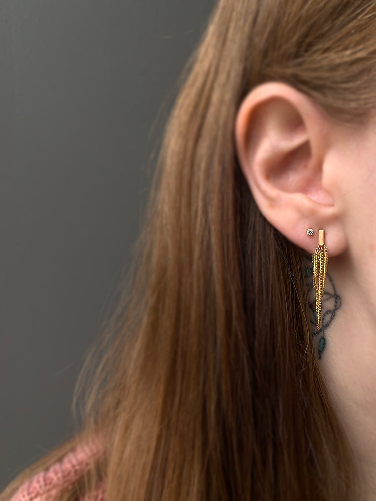 14k Chandelier Earrings modeled on a woman's ear