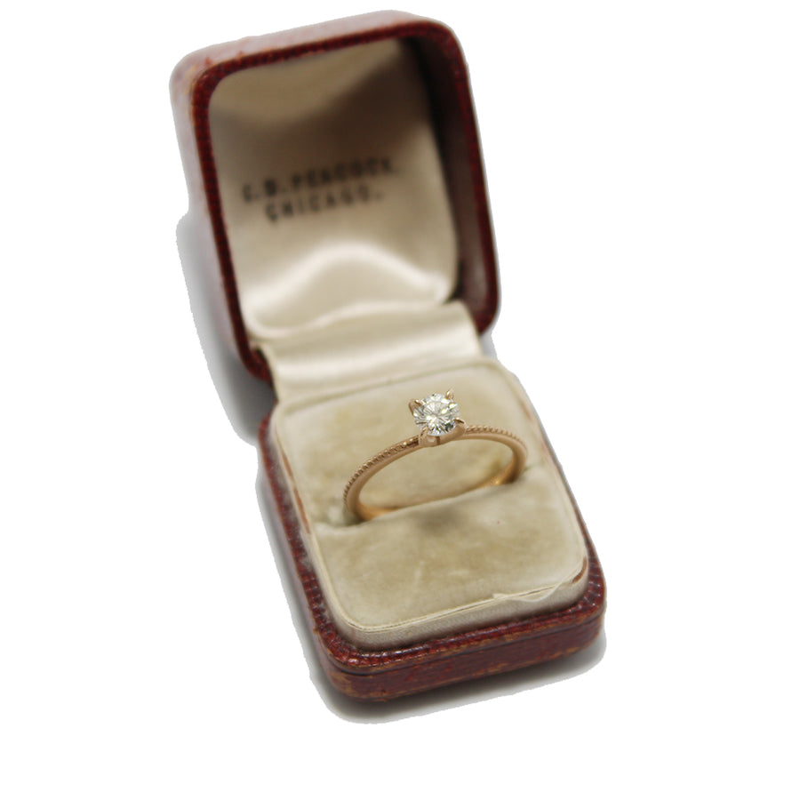 Jennifer Dawes Rose Gold Solitaire Diamond Ring in an antique ring box