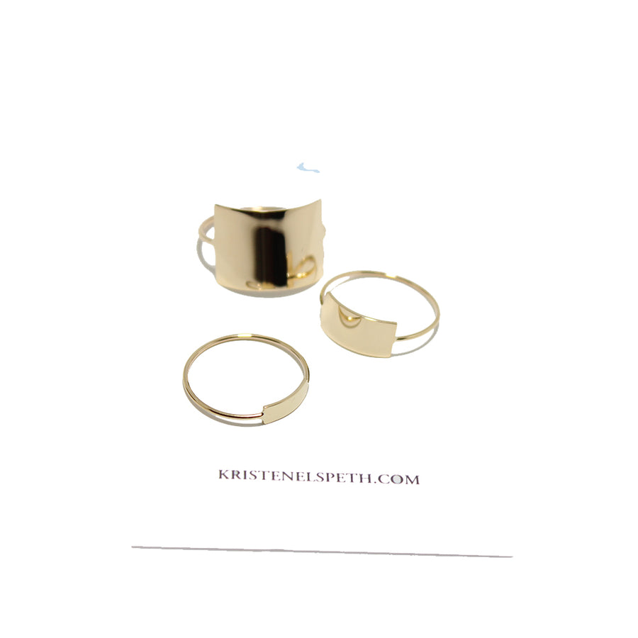 14k yellow gold rings with rectangular plates in varying sizes at Gem Jewelry Boutique