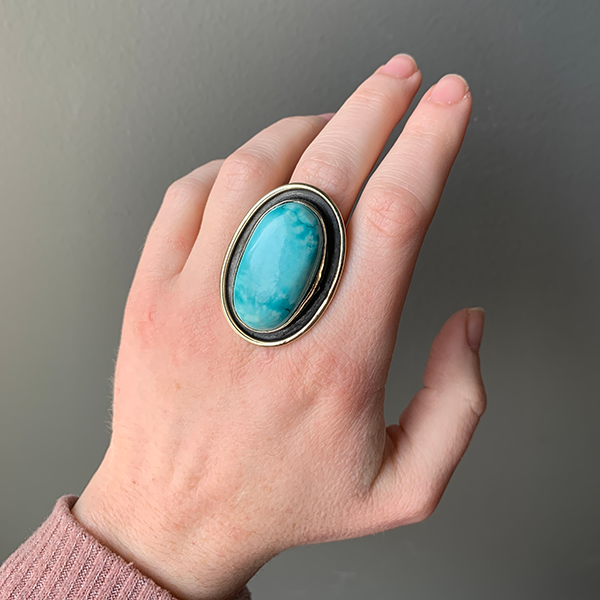 Large Oval Turquoise Ring modeled on a woman's hand