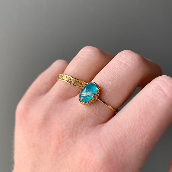 Nam 18k Gold Oval Rutile Quartz + Turquoise Ring and 18k gold lace dots ring modeled on a woman's hand