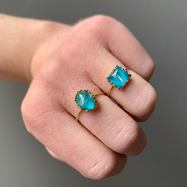 Nam 18k Gold Rutile Quartz + Turquoise rings modeled on a woman's hands