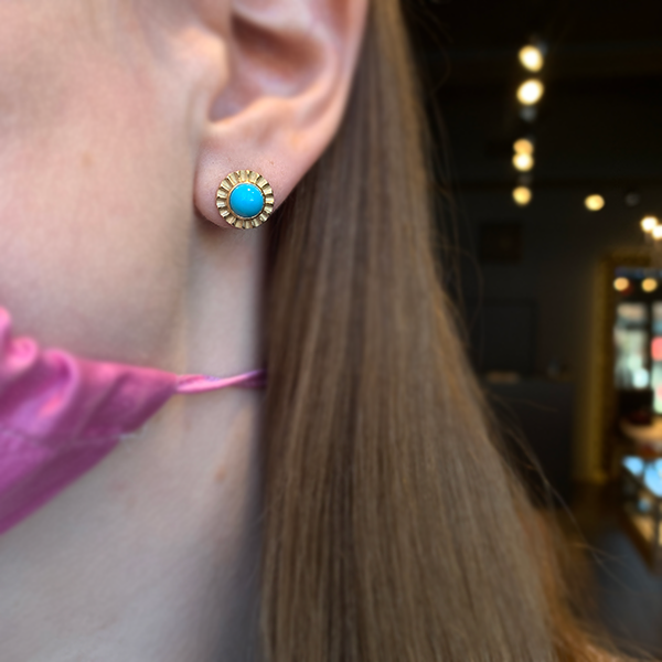 Pamela Zamore Turquoise Fluted Edge Stud Earrings modeled on an ear
