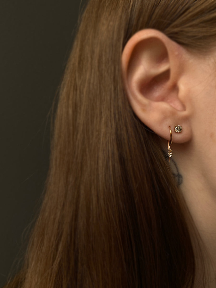 Jack & G 14k Gold Diamond Loopdie Earrings modeled on a woman's ear