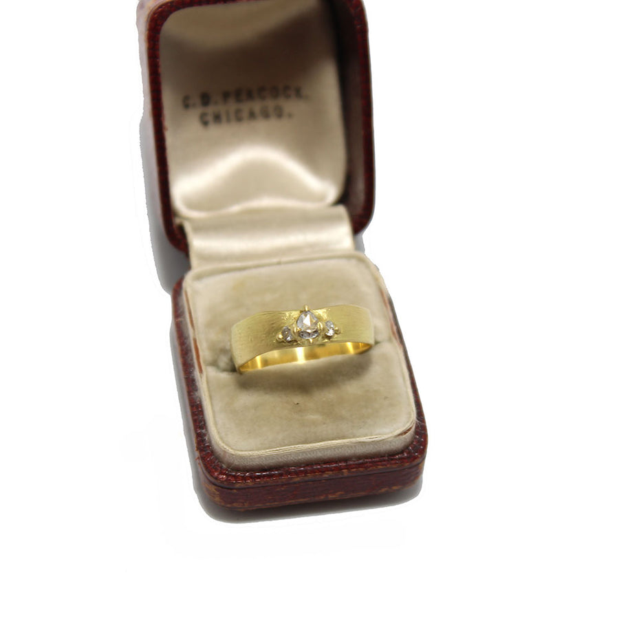 Polly Wales 18k gold Wide Pinched Diamond Band displayed in an antique ring box