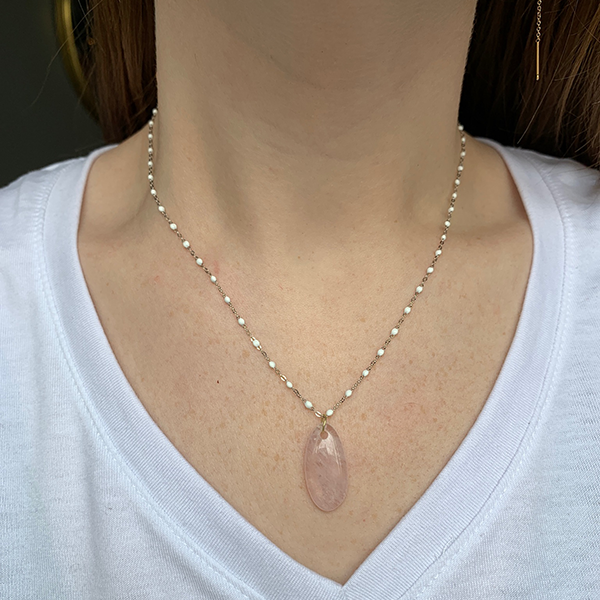 18k Gold + Rose Quartz Charm modeled on a white gold, white gigi clozeau necklace on a woman's neck