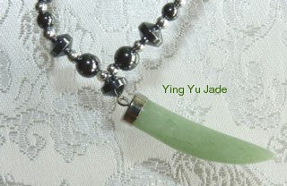 """Tiger Tooth"" Jade Pendant on  Hematite Necklace"