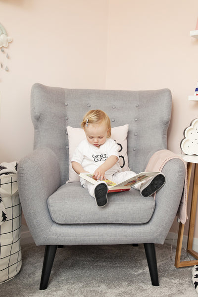 Alba The Modern Nursery reading a book
