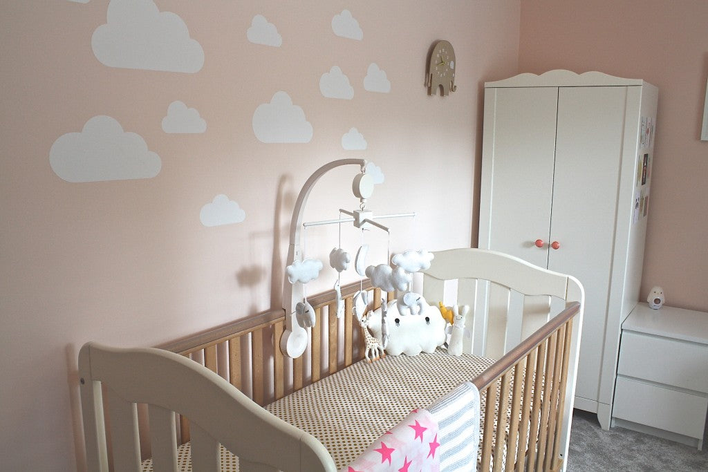 cot bed and cloud wall stickers