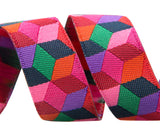 Tumbling Blocks in red, violet and pink by Kaffe Fassett