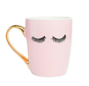 pink and gold coffee mug with eyelashes