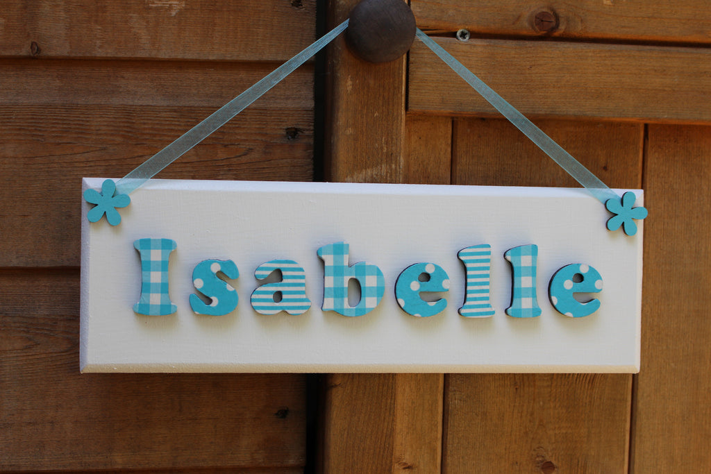 Turquoise and white plaque