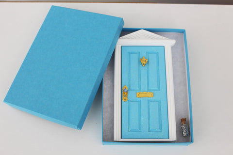 Opening blue elf door, post box and window