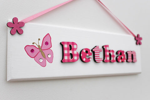 Butterfly illustrated pink plaque