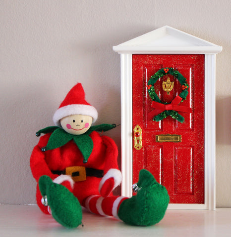 Opening Christmas elf door with santa workshop image, postbox, welcome mat and presents
