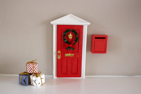 Closed Christmas elf door with miniature post box and presents
