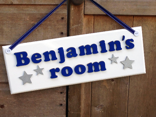 Navy and white wooden door sign with silver stars