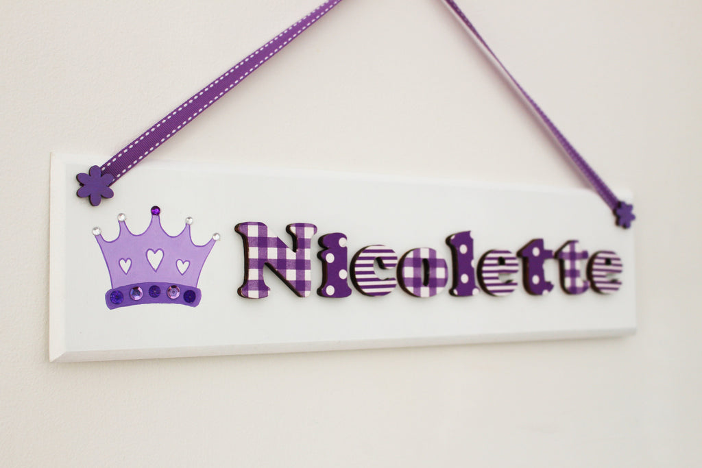 Purple and white plaque with princess crown illustration
