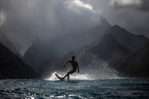 Photographer Alex Voyer shooting with Outex at Teahupoo's famous Surf Break 5