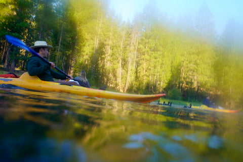 Chris Burkard kayaking in Sunriver, OR with Outex founder JR deSouza