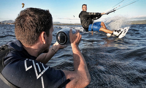 Photographer Lewis Deaves of Resonatemediahouse using Outex waterproof case for kitesurfing photography session