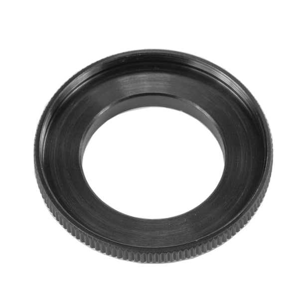 A black step up ring on a white background