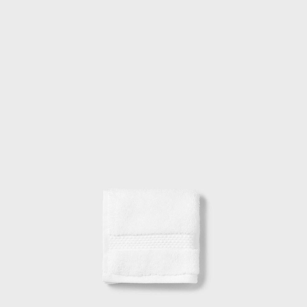 folded white cotton washcloth