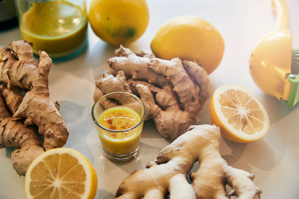 ginger and lemon and shot on a white kitchen table