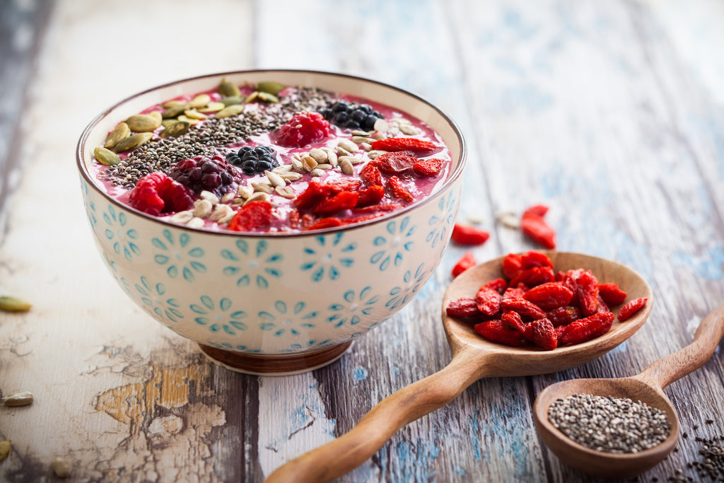 breakfast berry smoothie bowl topped with goji berries