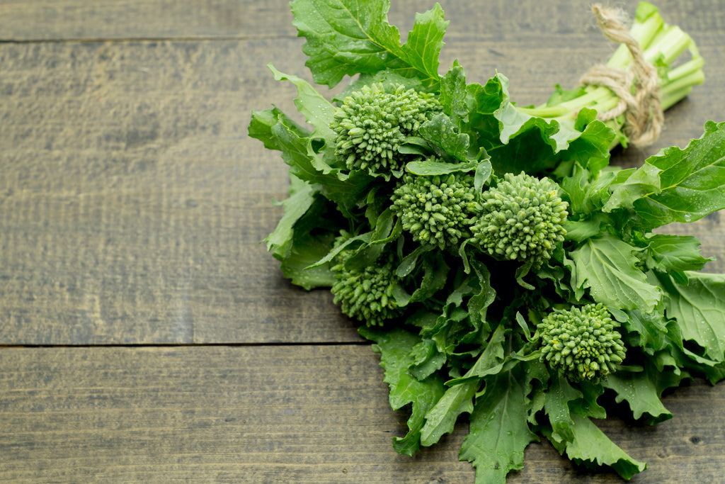 broccoli rabe on a wooden table