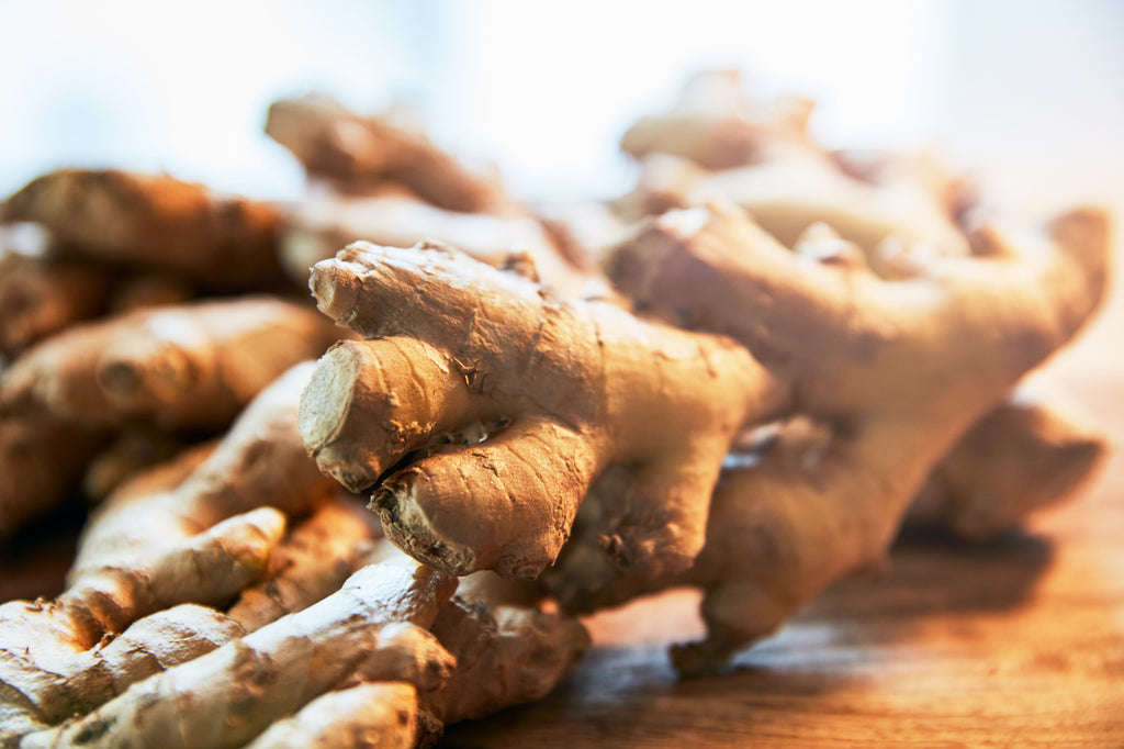 pile of ginger roots on wooden table