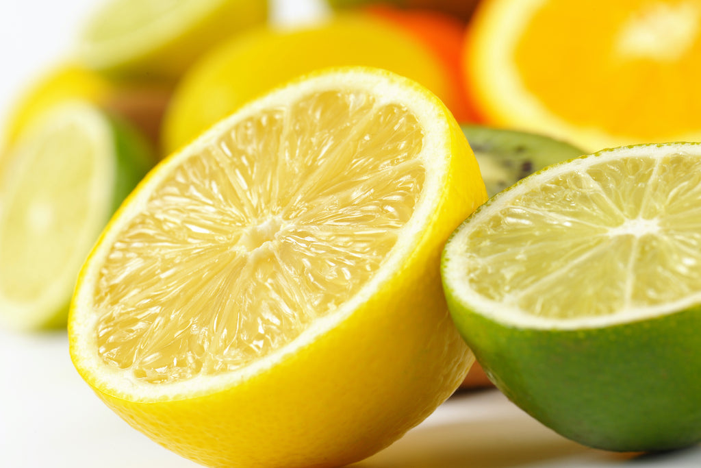 lemons and limes on a white table