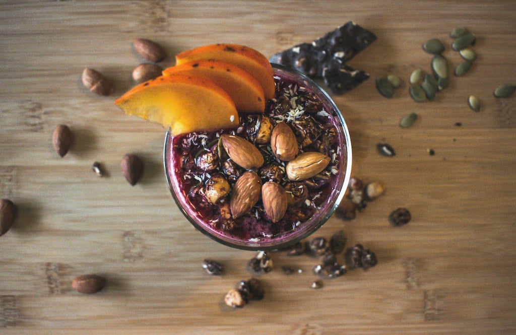 chia chocolate pudding in a cup on a wooden chopping board