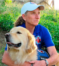 Operation Freedom Paws Mary Cortani and a Service Dog.