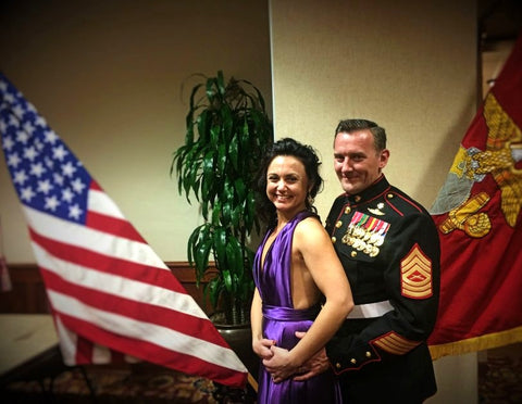 U.S. Marine Sean Brownlee with wife Genevieve Posed in Front of the American Flag