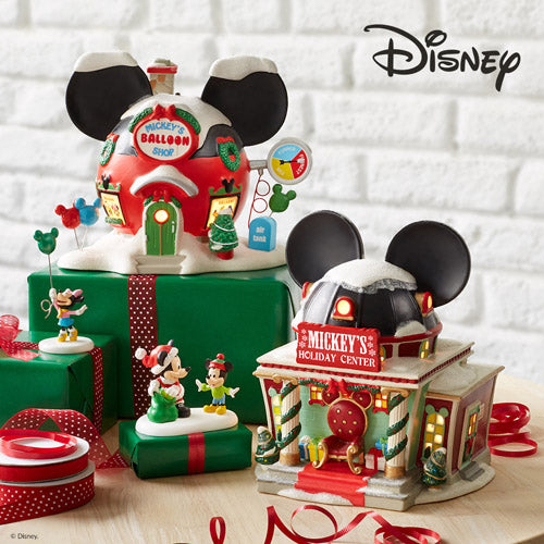 a place where christmas fills the air and holiday preparations never end mickeys christmas village brings holiday magic to your home with intricate