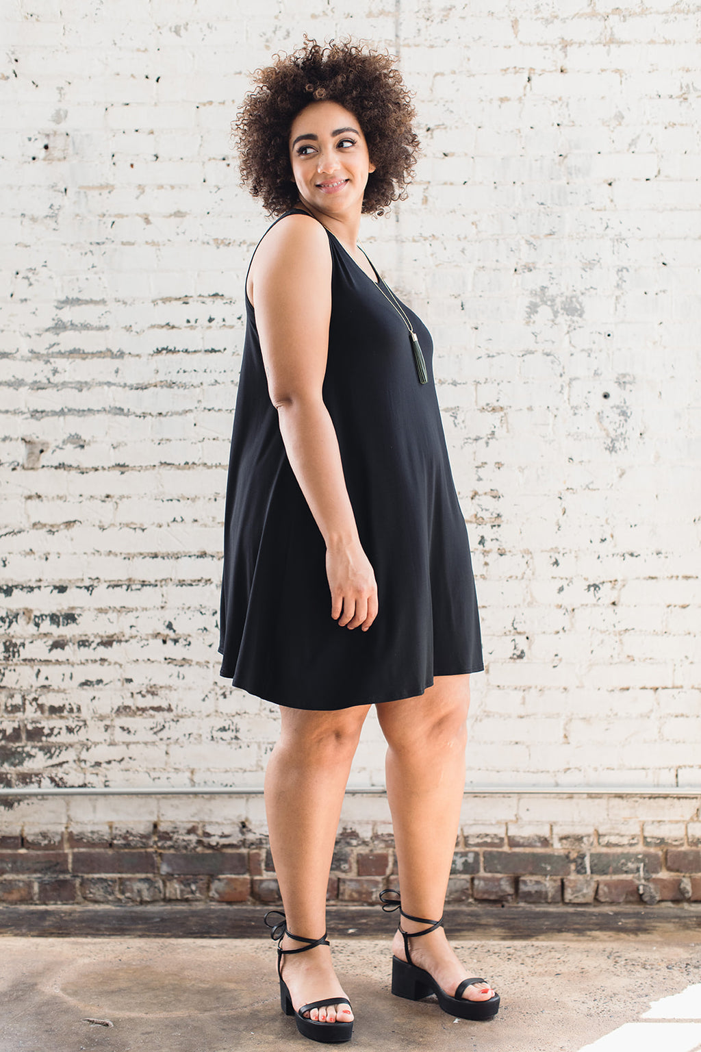 Sustainably made sleeveless flowy black dress