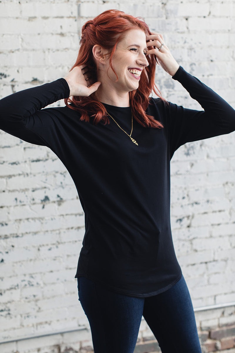 woman wearing a long sleeve bat wing top with crew neck