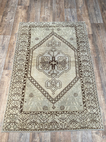 "4'3""x6'9"" Vintage Distressed Turkish Area Rug Designed by Zeki Muren"