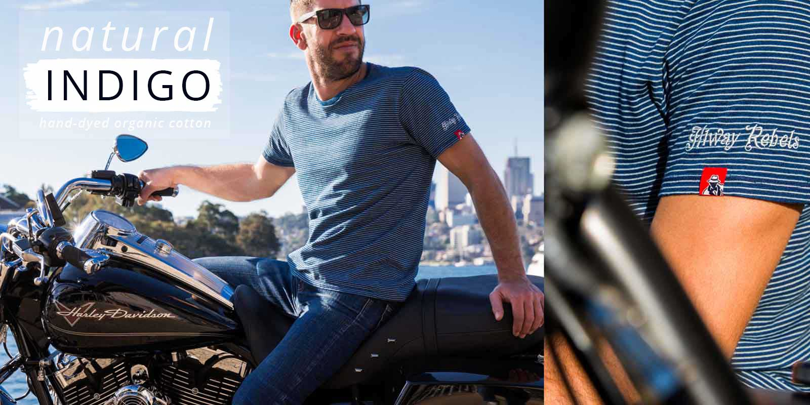 Man on Harley Davidson wearing Indigo Couture horizontal stripped navy and white Hiway Rebel t-shirt.