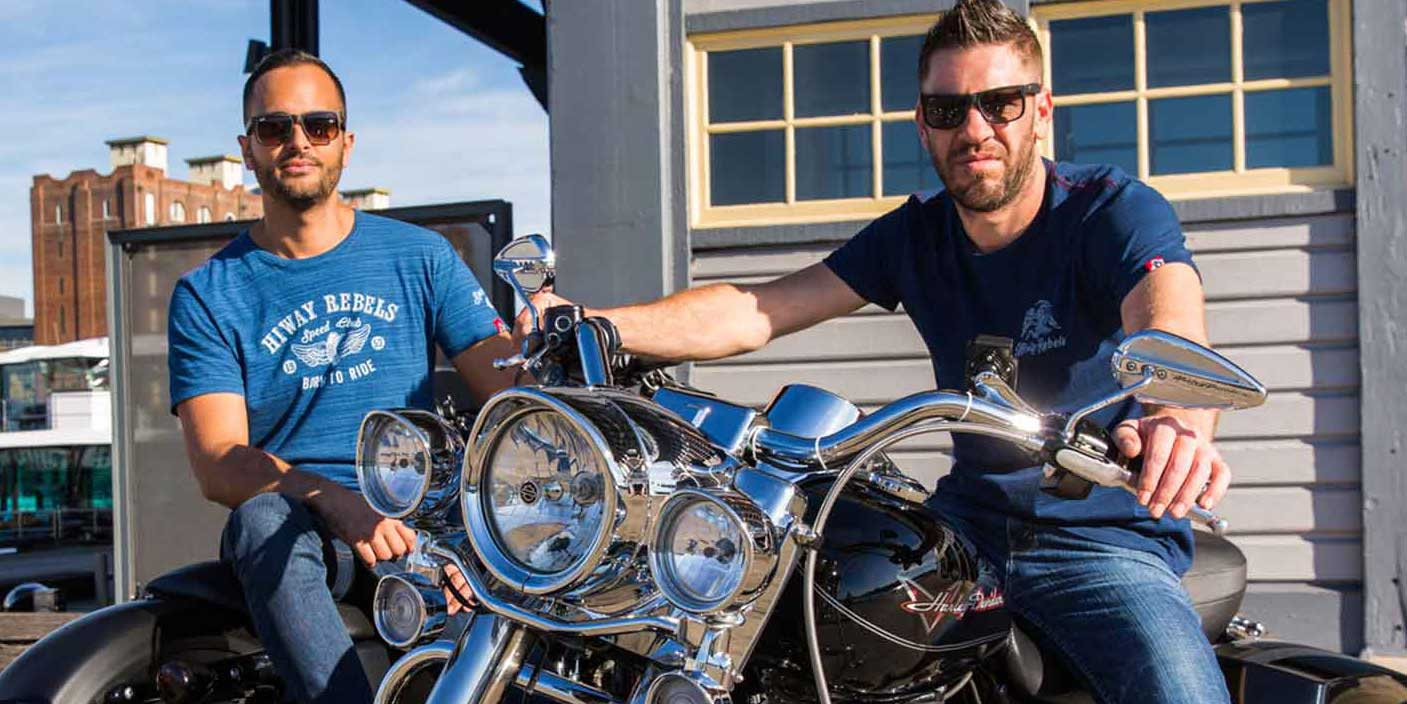 Two men on Harley Davidson bikes wearing Hiway Rebel indigo t-shirts